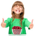 Cute Girl Is Eating Cherries Showing Thumb Up Sigh Royalty Free Stock Image - 47079696