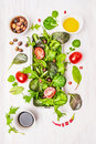 Wild Herbs Salad With Tomatoes,olives,oil And Vinegar On White Wooden Background Royalty Free Stock Image - 47080866