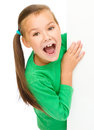 Little Girl Is Looking From Out Blank Board Royalty Free Stock Photo - 47081475