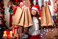 Young Woman With Shopping Bags On Christmas Stock Images - 47084854