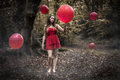 Teenage Girl Holding Red Balloon In Misty Forest With Floating B Royalty Free Stock Images - 47092079