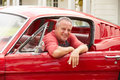 Retired Senior Man Sitting In Restored Classic Car Royalty Free Stock Images - 47093999