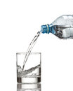 Cold Water Bottle Pour Water To Glass On White Royalty Free Stock Photo - 47097395
