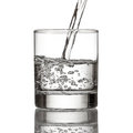 Cold Water Pour Water To Glass On White Royalty Free Stock Photos - 47097778