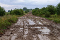 Muddy Dirt Road In A Hilly Countryside Royalty Free Stock Image - 47100736