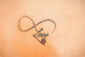 Photo Of Abstract Tattoo On Skin That Says Love Stock Photo - 47145420