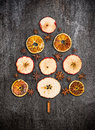 Christmas Tree Made Dry Apples, Oranges And Anise On Gray Texture Royalty Free Stock Photography - 47159167