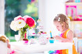 Little Girl Playing With Dolls Stock Image - 47167821