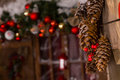Pine Cones Christmas Decors Hanging On Wall Royalty Free Stock Photo - 47171295