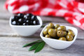Green And Black Olives In Bowl On Grey Wooden Background. Royalty Free Stock Image - 47177836