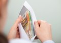 Person Checking Out Envelope With Cash Stock Images - 47187314