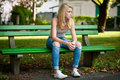 Beautiful Blonde Woamn Rests On A Bench In Park Stock Photo - 47188350