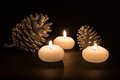 Burning Candles With Pine Apples At A Black Background Royalty Free Stock Images - 47211879
