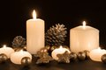 Burning Candles With Pine Apples And Gilded Stars On A Black Background Royalty Free Stock Photo - 47211885