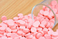 Many Pink Pills In Glass  For Health Care Concept Stock Image - 47222571