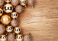 Gold Christmas Balls Over Wooden Background Stock Photos - 47228823