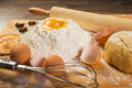 Baking Preparation: Eggs, Flour, Rolling Pin, Spices On A Board Stock Photos - 47230083