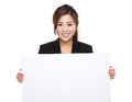 Businesswoman With White Banner Royalty Free Stock Images - 47230409