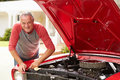 Retired Senior Man Working On Restored Classic Car Royalty Free Stock Image - 47240686