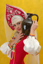 Woman In A Folk Russian Dress Holds A Jug Stock Photos - 4739533