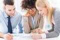 Young Business People Discussing In Office Royalty Free Stock Photography - 47313597