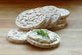 Rice Cakes, One With Cream Cheese And Herbs On A Wooden Board Stock Photo - 47321330