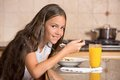 Girl Eating Cereal With Milk Drinking Orange Juice For Breakfast Royalty Free Stock Image - 47336626
