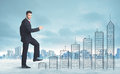 Business Man Climbing Up On Hand Drawn Buildings In City Royalty Free Stock Photos - 47345948