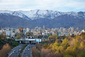 Tehran Skyline And Highway In Front Of Snowy Mountains Stock Image - 47354051