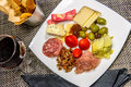 Cheese, Nut And Meat Plate With Bread Sticks And Red Wine Stock Images - 47380154