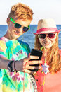 Teenagers Are Making Self Portrait And Listening  Listening Music On The Sea Background. Royalty Free Stock Image - 47384756
