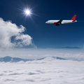 Airplane Flying At High Altitude Above The Clouds Royalty Free Stock Image - 47400496