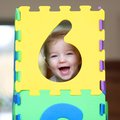 Preschooler Girl Playing With Puzzles Learning Numbers Royalty Free Stock Photos - 47408088