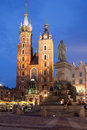 St Mary Basilica And Adam Mickiewicz Monument At Night In Krakow Stock Photos - 47417923