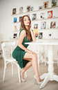 Fashionable Attractive Young Woman In Green Dress Sitting In Restaurant Stock Image - 47434761