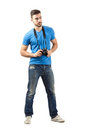 Young Man Standing With Digital Camera Around Neck Stock Images - 47436414