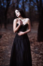 A Beautiful Sad Goth Girl Stands In Grove Royalty Free Stock Image - 47441546