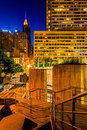 Stairs And Buildings At Night At The Inner Harbor In Baltimore, Royalty Free Stock Photos - 47445688