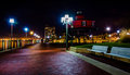 Waterfront Promenade And Lighthouse At Night In The Inner Harbor Royalty Free Stock Photos - 47464748