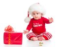 Little Girl Weared Santa Clothes With Gift Box Stock Image - 47471311