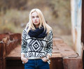 Young Cute Blonde Woman In Sweater, Scarf, And Jeans Outdoors Portrait With Abandoned Grunge Background Royalty Free Stock Photography - 47490157
