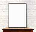White Frame Mock Up On The Wood Table At White Brick Wall Stock Image - 47492071