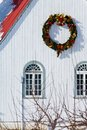 A Christmas Wreath Haning On A Building Stock Photos - 4752303