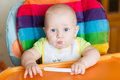Adorable Baby Eating In High Chair Stock Photos - 47511703