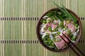 Vietnamese Pho Bo Soup With Beef Rare, Rice Noodles And Fresh He Royalty Free Stock Photo - 47538925