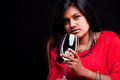 Indian Girl With A Glass Of White Wine Royalty Free Stock Images - 47543249