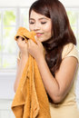 Young Woman Smelling Clean Fresh Laundry Stock Images - 47547744