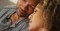 Black Couple Resting Their Heads Together Stock Image - 47557761
