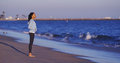 Black Woman Enjoying The Ocean View Until Waves Come Royalty Free Stock Photography - 47558507