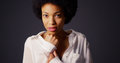 Black Woman In White Blouse Holding Hands Up To Face And Looking At Camera Royalty Free Stock Photography - 47558517